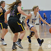 Photo by Aaron Beckman  <br /> <br /> Ponca's MacKenzie Boyle dribbles around Emerson-Hubbard's Payton Blanke Friday night in Ponca.