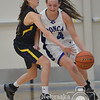 Photo by Aaron Beckman  <br /> <br /> Emerson-Hubbard's Maddie Martin attempts to knock the ball away from Ponca's Kianna Kramper  Friday night in Ponca.