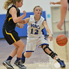 Photo by Aaron Beckman  <br /> <br /> Ponca's MacKenzie Boyle passes a ball around Emerson-Hubbard's Morgan Hansen Friday night in Ponca.