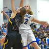 Photo by Aaron Beckman  <br /> <br /> Ponca's Hannah Albrecht blocks a shot from Emerson-Hubbard's Maddie Martin Friday night in Ponca.
