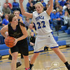Photo by Aaron Beckman  <br /> <br /> Ponca's Hannah Albrecht guards against Emerson-Hubbard's Tessa Stewart Friday night in Ponca.