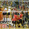 Photo by Aaron Beckman  <br /> <br /> The Lady Huskers celebrate their championship after they swept Texas in the NCAA Volleyball Tournament.