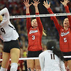 Photo by Aaron Beckman  <br /> <br /> Husker's Kelly Hunter(3) and Amber Rolfzen(5) go up to block a spike from Texas's Amy Neal Saturday night in Omaha.