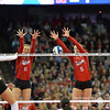 Photo by Aaron Beckman  <br /> <br /> Nebraska's Amber and Kadie Rolfzen block a ball against Texas Saturday night in Omaha.