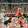 Photo by Aaron Beckman<br /> <br /> Lady Husker's Cecilia Hall(9), Kelly Hunter (3), and J Wong-Orantes celebrate the wining point in the 3rd set to sweep Texas in the Championship game of the NCAA Volleyball Tournament.