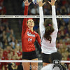 Photo by Aaron Beckman  <br /> <br /> Nebraska's Kelsy Fien spikes a ball against Texas's Amy Neal Saturday night in Omaha.