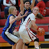 Photo by Aaron Beckman  <br /> <br /> Wynot's Carissa Kuchta and Courtney Arkfeld boxes in Randolph's Haley Schnoor Tuesday night in Randolph.