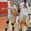 Photo by Aaron Beckman  <br /> <br /> Randolph's Katelyn Backhaus (24) sets up a pick against Wynot's Danielle Wieseler to free up fellow teammate Haley Schnoor Tuesday night in Randolph.