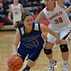 Photo by Aaron Beckman  <br /> <br /> Wynot's Danielle Wieseler attempts to drive around Randolph's Katie Fye Tuesday night in Randolph.