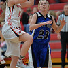 Photo by Aaron Beckman  <br /> <br /> Randolph's Elle Bermel  goes up for a jump shot against Wynot's Courtney Arkfeld Tuesday night in Randolph.