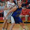 Photo by Aaron Beckman  <br /> <br /> Wynot's Kristin Burning blocks out Randolph's Megan Fink Tuesday night in Randolph.