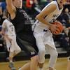 Photo by Aaron Beckman  <br /> <br /> Battle Creek's Jake Finkral attempts to block Winnebago's David Wingett from going to the basket Tuesday night in Wisner.