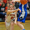 Photo by Aaron Beckman  <br /> <br /> Norfolk Catholic's Bailey Barnes passes the ball around Pierce's Allison Koehlmoos Thursday night during the C1-8 Girls Subdistrict play. The Lady Knights ended up beating the Lady Blue Jays.