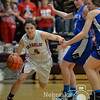Photo by Aaron Beckman  <br /> <br /> Norfolk Catholic's Joelle Heng dribbles around a couple of Pierce Lady Bluejay's defenders Thursday night during the C1-8 Girls Subdistrict.