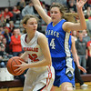 Photo by Aaron Beckman  <br /> <br /> Pierce's Jaci Brahmer blocks in Norfolk Catholic's Courtney Schindler Thursday night in Norfolk during the girls C1-8 Subdistricts.