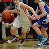 Photo by Aaron Beckman  <br /> <br /> Lady Knight, Madeline Love dribbles around Pierce's Shelby Bretschneider Thursday night in Norfolk during C1-8 Girls Subdistricts.