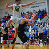 2-20-2018<br /> 51/365<br /> Jayden Raabe from Wisner-Pilger goes up to block a shot from Blake Freudenburg from Lutheran High Northeast Tuesday night in Norfolk. <br /> Photo taken with a Sony A7rM3 with a Sony FE 70-200F4<br /> ISO 8000<br /> 1/800th at F4<br /> (31471)