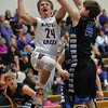 Photo by Aaron Beckman  <br /> <br /> Battle Creek's Kobe Lade drives through a couple of Lutheran High defenders Tuesday night in Stanton during the second round of the C2-6 Subdistrict basketball game.