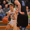 Photo by Aaron Beckman  <br /> <br /> Battle Creek's Jared Bellar attempts to drive around Lutheran High's Kyle Rosberg Tuesday night during the second round of the C2-6 Boys Subdistirct basketball.