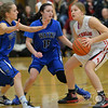 Photo by Aaron Beckman  <br /> <br /> Wayne's Kylie Hammer and Rachel Rauner blocks in Norfolk Catholic's Kristin Maguire during the Girls Mid-State Conference basketball game in Battle Creek Wednesday night.