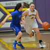 Photo by Aaron Beckman  <br /> <br /> Norfolk Catholic's Maddie Love dribbles around Wayne's Rachel Rauner Wednesday night in Battle Creek during the Girls  Mid-States Conference Tournament.