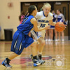 Aaron Beckman  <br /> <br /> Guardian Angels Central Catholic's Kate Knobbe attempts to dribble around Wayne's Kelsey Boyer durning the Mid-State Conference tournament Thursday night.