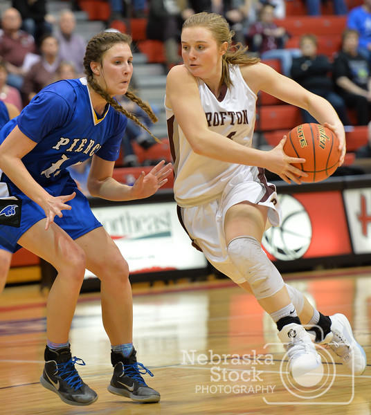Aaron Beckman    Crofton's Monica Arens drives around Pierce's Jaci Brahmer Thursday night during the Girls Mid-State Conference Tournament.