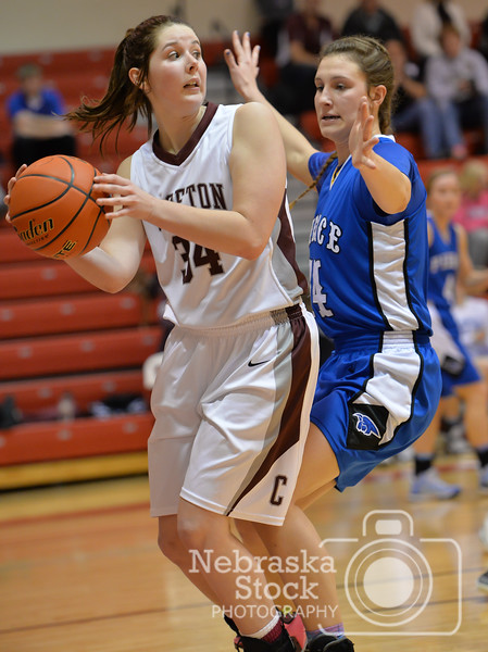 Aaron Beckman  <br /> <br /> Pierce's Jaci Brahmer attempts to block Crofton's Katie Petersen from throwing the ball Thursday night during the Girls Mid-State Conference Tournament.