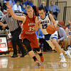 Aaron Beckman  <br /> <br /> O'Neill's Jake Young drive the ball around Boone Central/Newman Grove's Dylan Gentrup Friday night during the Boys Mid-State Conference Tournament.