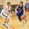 Aaron Beckman  <br /> <br /> Pierce's Taggart Bailey attempts to dribble around Guardian Angels Central Catholic's Kobe Slaughter Friday night during the Boys Mid-State Conference Tournament.