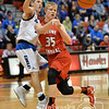 Aaron Beckman  <br /> <br /> Boone Central/Newman Grove's Dylan Gentrup passes the ball around O'Neill's Justin Appleby Friday night during the Boys Mid-State Conference Tournament.