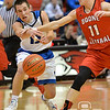 Aaron Beckman  <br /> <br /> O'Neill's Jake Young passes the ball around Boone Central/Newman Grove's Cody Nelson Friday night during the Boys Mid-State Conference Tournament.