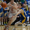Photo by Aaron Beckman  <br /> <br /> Hartington CC's Bennet Steffen drives through West Holt's Payton Williams Monday night in Pierce during the Boys C2-4 District Finals.