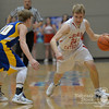 Photo by Aron Beckman  <br /> <br /> Hartington CC's James Kaiser dribbles around West Holt's Josiah McAllister Monday night in Pierce during the Boys C2-4 District Finals.