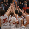 Photo by Aaron Beckman<br /> <br /> Hartington CC Boy's Basketball team hoist up the C2-4 District Championship plaque after defeating the West Holt Huskies Monday night in Pierce.