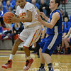 Photo by Aaron Beckman  <br /> <br /> Omaha Nation's Adrian Freemont attempts to dribble past Bloomfield's Cody Beckman Tuesday night in Norfolk. Bloomfield ended up defeating the Chiefs to win the Boys D1 District Championship.