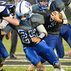 Photo by Aaron Beckman  <br /> <br /> Eagle's quaterback Ayden Wiederin follows a block from teammate Justice Nedela Thursday night against the Ponca Indians.