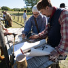 Aaron Beckman/DailyNews  <br /> <br /> From left to right, Steve Grimme, Charles Reitz, and Rodger Fisher tally up their scores from their muzzleloader shooting event held during the North Fork Frontiersmen rendezvous this past weekend north of Battle Creek along the Elkhorn River.