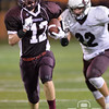 Photo by Aaron Beckman  <br /> <br /> Norfolk's Aaron Wilken outruns Columbus's Cameron Krueger Thursday night in Norfolk. The Panthers went on to defeat the Discovers 34-14.