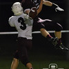 Photo by Aaron Beckman  <br /> <br /> Panther's receiver Aaron Wilken goes up for a pass against Columbus's Trevor Sanne Thursday night in Norfolk.
