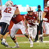Aaron Beckman/DailyNews  <br /> <br /> Nebraska's Devine Ozigbo (22) follows Luke McNitt (41) against Fresno State Saturday in Lincoln.