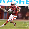 Aaron Beckman/DailyNews  <br /> <br /> Nebraska's Devine Ozigbo (22) makes a cut between Fresno State's DeShawn Potts (11) and Robert Stanley (32) Saturday in Lincoln.