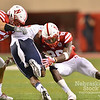 Aaron Beckman/DailyNews  <br /> <br /> Nebraska's Josh Banderas (52) and Kieron Williams (26) tackels Fresno State's Dontel James (28) Saturday in Lincoln.