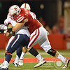 Aaron Beckman/DailyNews  <br /> <br /> Nebraska's Mick Stoltenberg(44) wraps up Fresno State's quarterback Zack Kline (10) Saturday in Lincoln.