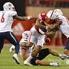 Aaron Beckman/DailyNews  <br /> <br /> Nebraska's Cethan Carter (11) gets wrapped up by a few of  Fresno State's defenders Saturday in Lincoln.