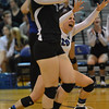 Photo by Aaron Beckman  <br /> <br /> Lutheran High's Samantha Wolf (20) and Trystin Baker celebrate a point in the second set against the Lady Knights Tuesday night. The Lady Eagles swept Norfolk Catholic in 3 sets.