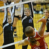 Photo by Aaron Beckman  <br /> <br /> Lady Eagle's Beth Skoglund (10) and Emma Rosberg (1) attempt to block a spike from Norfolk Catholic's Maddie Love Tuesday night. Lutheran High swept the Lady Knights in 3 sets.