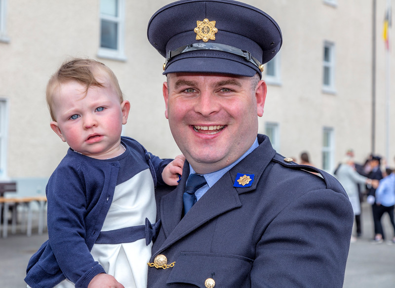 07/06/2016  XXjob News   Templemore Garda Síochána College, Templemore, Co. Tipperary passing out parade.  Newly graduated officers Odhran McIntyre with his daughter Fodhla.  Picture: Andy Jay