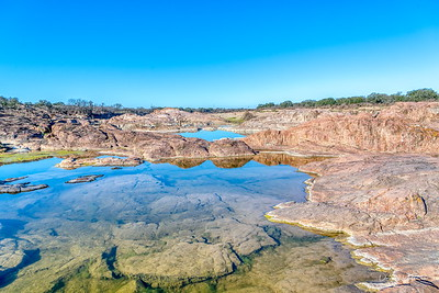 The following are images of clear pools left behind by the Central Texas flooding along the Llano River
