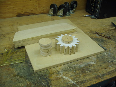 Gears cut and the teeth filed to fit the pattern, in the rear are the bearing mounts for the shafts.